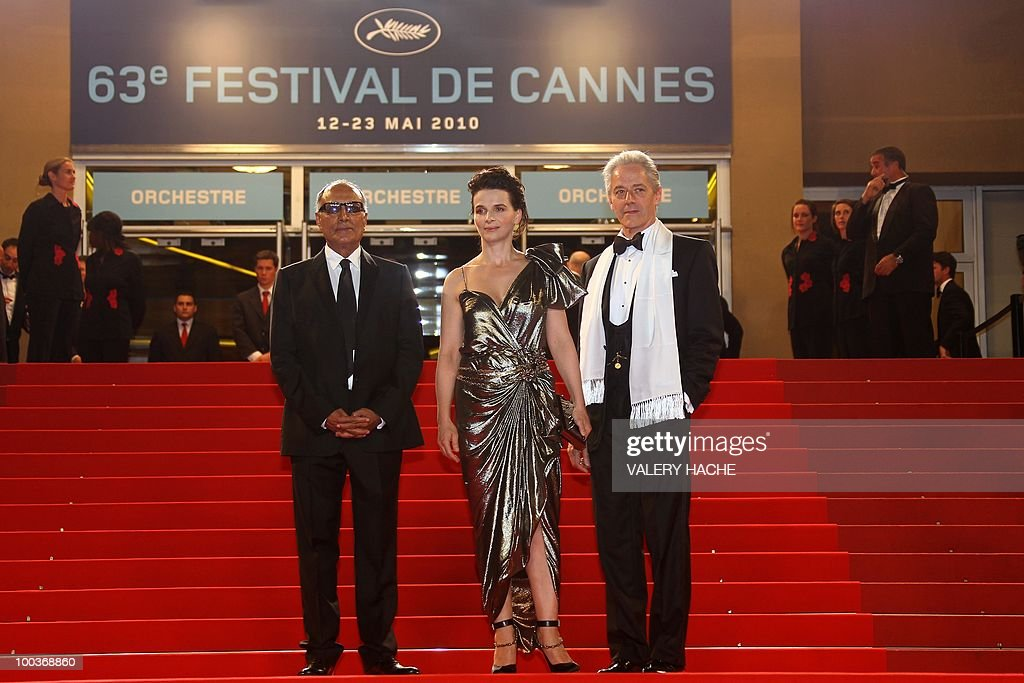 Iranian director Abbas Kiarostami, French actress Juliette Binoche and British actor William Shimell arrives for the screening of 'Copie Conforme (Certified Copy) presented in competition at the 63rd Cannes Film Festival on May 18, 2010 in Cannes.