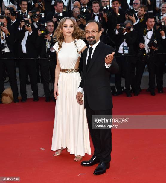 Iranian director Asghar Farhadi and French model Lily Rose Depp arrive for the screening of the film 'Les Fantomes dIsmael' out of competition and...