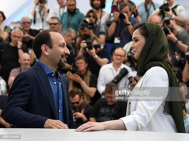Iranian director Asghar Farhadi and Iranian actress Taraneh Alidoosti pose on May 21 2016 during a photocall for the film The Salesman at the 69th...
