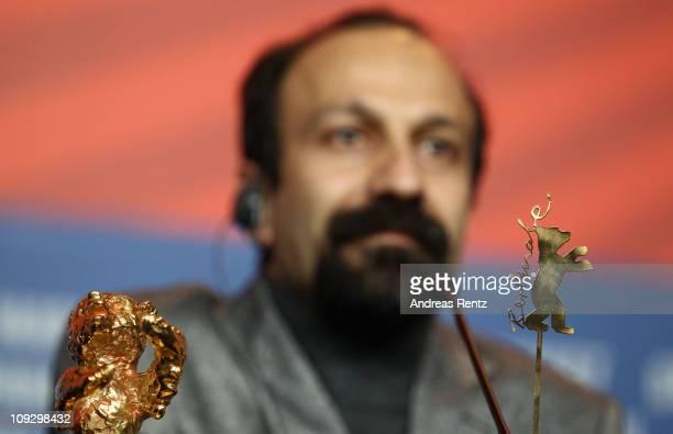Iranian director Asghar Farhadi attends the Award Winner Photocall after winning the Golden Bear prize for his film 'Jodaeiye Nader Az Simin' Nader...