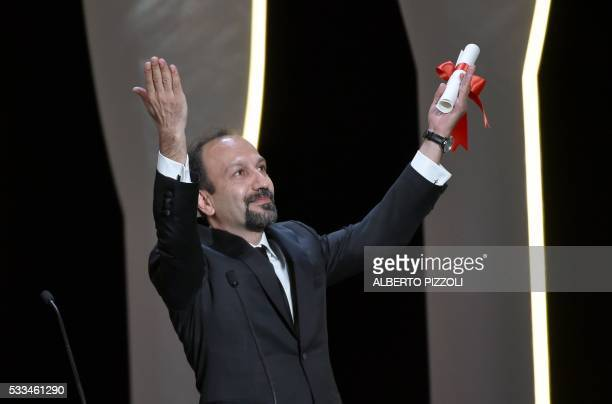 Iranian director Asghar Farhadi celebrates after being awarded with the Best Screenplay prize for the film The Salesman during the closing ceremony...