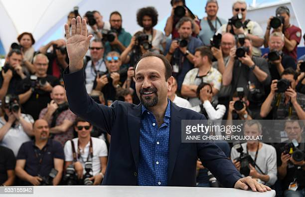 Iranian director Asghar Farhadi waves on May 21 2016 during a photocall for the film The Salesman at the 69th Cannes Film Festival in Cannes southern...