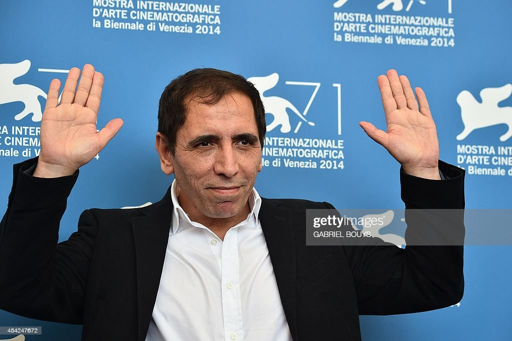 Iranian director Mohsen Makhmalbaf poses during the photocall of his movie 'The President' presented in the 'Orizzonti' selection at the 71st Venice Film Festival on August 27, 2014 at Venice Lido.