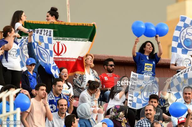 Iranian fans cheer during the AFC Champions League football match between Saudi's AlHilal club and Iran's Esteghlal club at the Kuwait Sports Club...