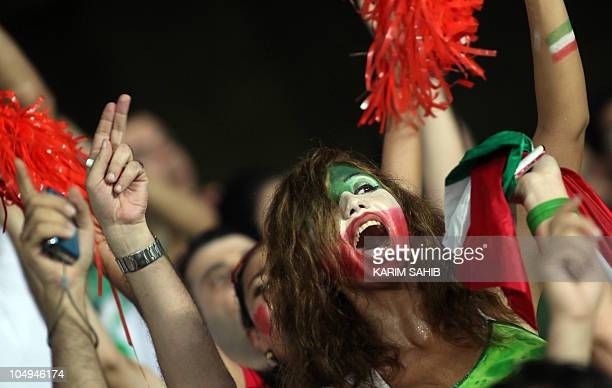 Iranian fans cheer for their national football team prior to the start of a friendly game against Brazil in Abu Dhabi on October 7 2010 AFP...