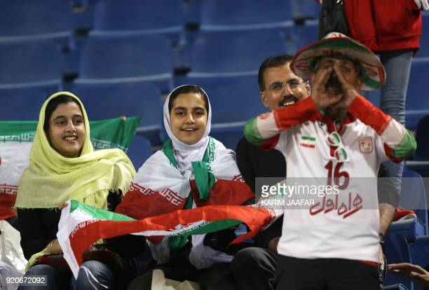 Iranian fans watch the AFC Champions League Group A football match between Qatar's AlGharafa and Tractor Sazi Tabriz of Iran at the Thani Bin Jassim...