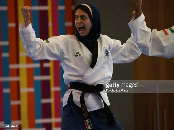 Iranian female athlete wearing a hijab giving a shout in the competition of the 10th WTF World Taekwondo Poomsae Championship taking place in Lima...
