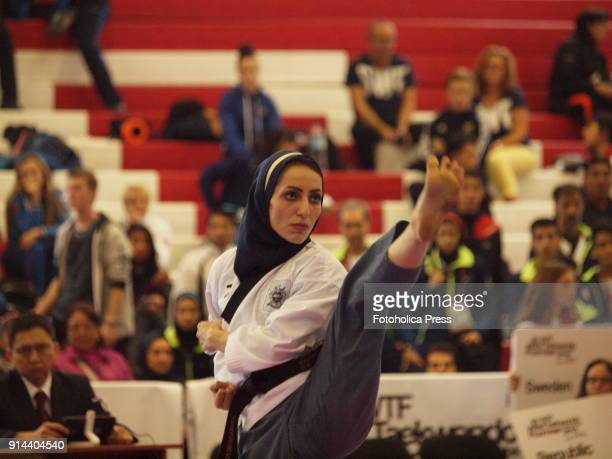 Iranian female athlete wearing a hijab running a kick in the competition of the 10th WTF World Taekwondo Poomsae Championship taking place in Lima,...