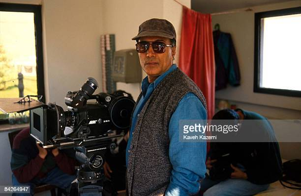 Iranian film director Abbas Kiarostami during a location shoot 1st October 1996