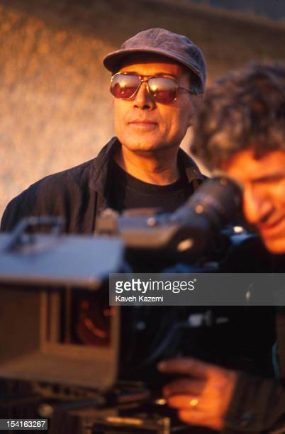 Iranian film director Abbas Kiarostami on the set of 'Taste Of Cherry' Tehran Iran 1st October 1996 The film was awarded the Palme d'Or at the 1997...