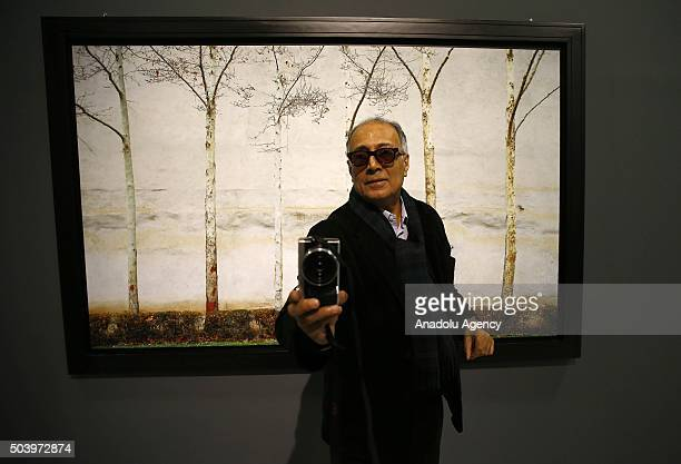 Iranian film director screenwriter photographer and film producer Abbas Kiarostami poses during a press conference prior to his most comprehensive...