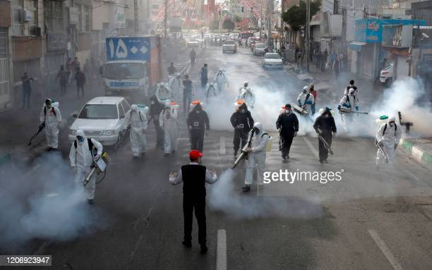 Iranian Firefighters disinfect streets in the capital Tehran in a bid to halt the wild spread of coronavirus on March 13 2020 Iranian forces will...