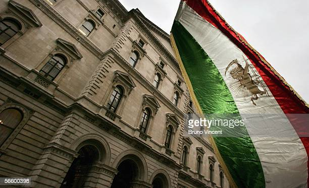 Iranian flag is waved by a supporter of the National Council of Resistance of Iran during a protest outside the Foreign and Commonwealth Office on...