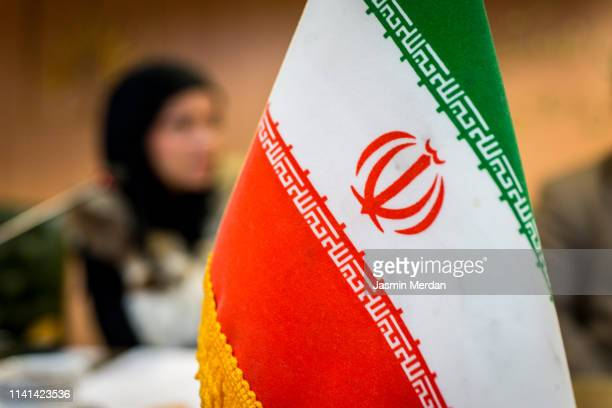 iranian flag on conference table - iranian culture stock photos and pictures
