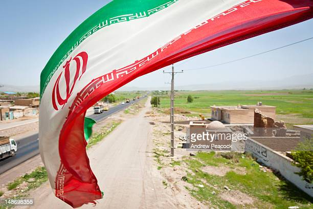 iranian flag on pedestrian overpass on highway 16 between sarab and nir. - iranian flag stock photos and pictures