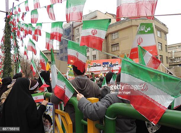Iranian flags and people march at Islamic Revolution anniversary rally, national day of Iran