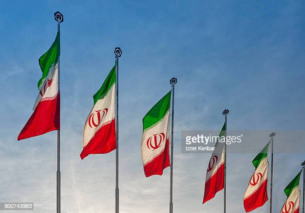 iranian flags displayed on streets - iranian flag stock photos and pictures