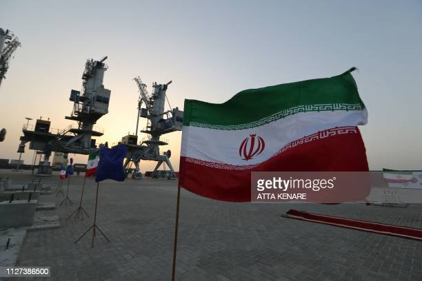 Iranian flags flutter during an inauguration ceremony for new equipment and infrastructure on February 25 2019 at the Shahid Beheshti Port in the...