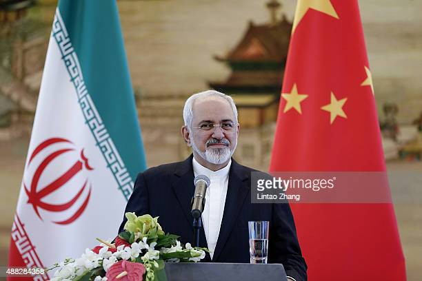 Iranian Foreign Minister Javad Zarif answers questions during a press conference after meeting with Chinas Foreign Minister Wang Yi on September 15...