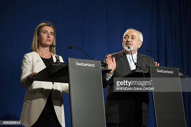Iranian Foreign Minister Javad Zarif delivers a statement flanked by European Union High Representative for Foreign Affairs and Security Policy...