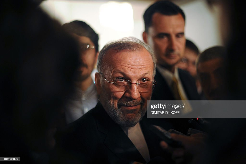 Iranian Foreign Minister Manouchehr Mottaki looks out from over his glasses as he speaks to journalists during a meeting of the Organization of the Black Sea Economic Cooperation (BSEC) in Sofia on May 28, 2010.