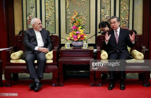 Iranian Foreign Minister Mohammad Javad Zarif and his Chinese counterpart Wang Yi iduring their meeting at the Diaoyutai State Guesthouse on February...