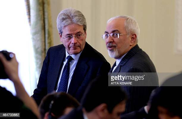 Iranian Foreign Minister Mohammad Javad Zarif and his Italian counterpart Paolo Gentiloni hold a press conference following a meeting on February 28...