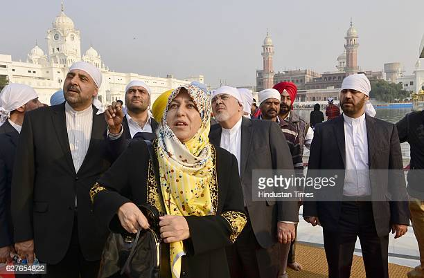 Iranian Foreign Minister Mohammad Javad Zarif and his wife Maryam Imanieh with delegation members paying obeisance at Golden Temple on December 4...