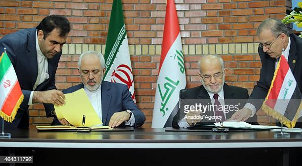 Iranian Foreign Minister Mohammad Javad Zarif and Iraqi Foreign Minister Ibrahim alJaafari are seen as they sign memorandum of understanding in...