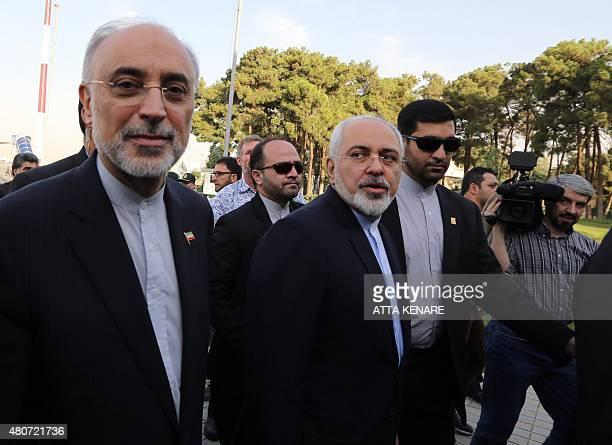Iranian Foreign Minister Mohammad Javad Zarif and the head of Iran's Atomic Energy Organization Ali Akbar Salehi arrive at Tehran's Mehrabad Airport...