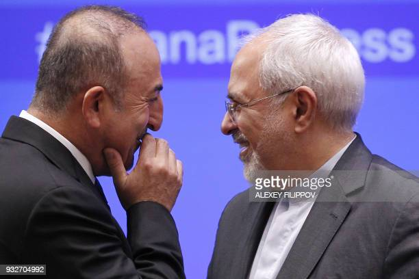 Iranian Foreign Minister Mohammad Javad Zarif and Turkish Foreign Minister Mevlut Cavusoglu attend a meeting on Syria in Astana on March 16 2018 /...