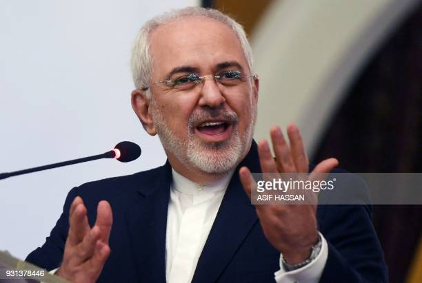 Iranian Foreign Minister Mohammad Javad Zarif gestures while speaking at the IranPakistan Business Forums in Karachi on March 13 2018 Zarif is on...