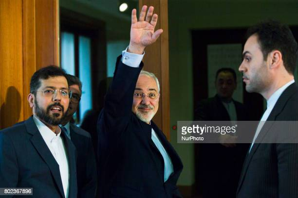 Iranian Foreign Minister Mohammad Javad Zarif greets as he leaves a news conference at the Foreign Ministry in Berlin on June 27 2017