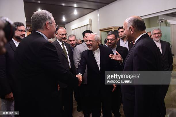 Iranian Foreign Minister Mohammad Javad Zarif greets Pakistani politician at the Foreign Ministry in Islamabad on April 8 2015 Iran and Pakistan on...
