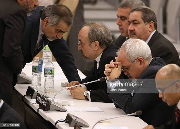Iranian Foreign Minister Mohammad Javad Zarif holds his head in his hands ahead of the address by Iranian President Hassan Rouhani at the U.N....