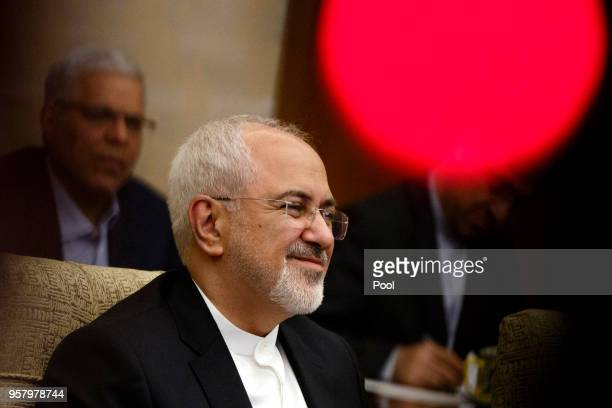 Iranian Foreign Minister Mohammad Javad Zarif holds talks with Chinese State Councillor and Foreign Minister Wang Yi at Diaoyutai state guesthouse on...
