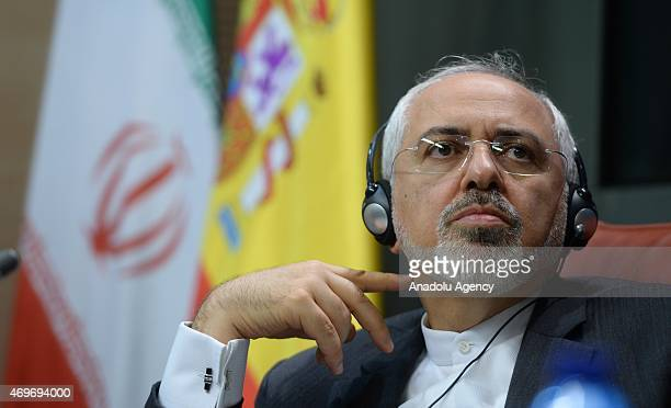 Iranian Foreign Minister Mohammad Javad Zarif listens during a joint press conference with Spain's Foreign Minister Jose Manuel Garcia Margallo after...