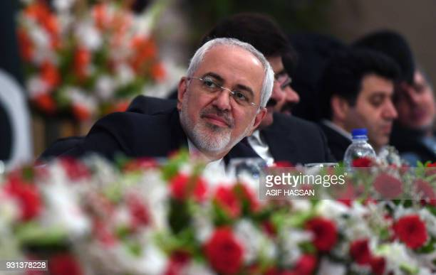 Iranian Foreign Minister Mohammad Javad Zarif looks on while attending the IranPakistan Business Forums in Karachi on March 13 2018 Zarif is on...