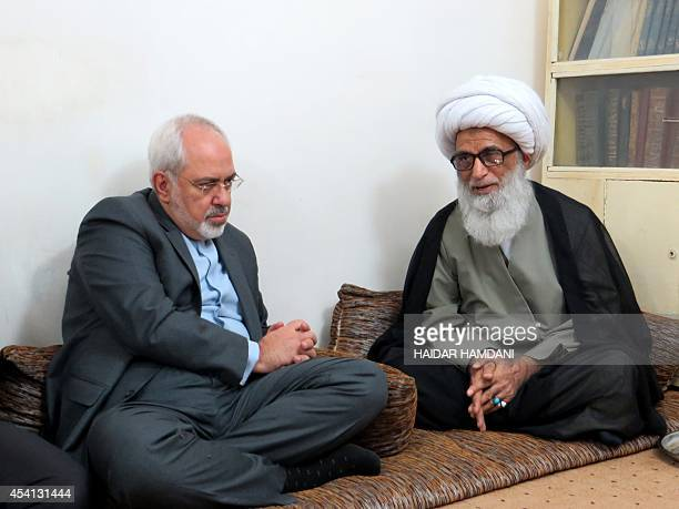 Iranian Foreign Minister Mohammad Javad Zarif meets with Shiite Grand Ayatollah Bashir alNajafi during a visit in the holy city of Najaf on August 25...