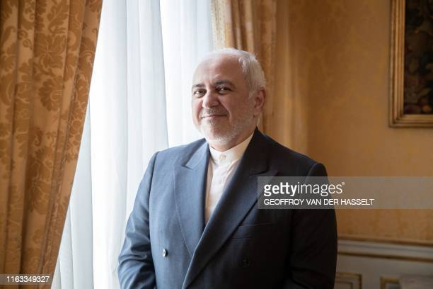 Iranian Foreign Minister Mohammad Javad Zarif poses for a photograph during an interview with Agence France-Presse at the residence of Iranian...