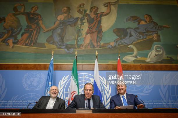 Iranian Foreign Minister Mohammad Javad Zarif Russian Foreign Minister Sergei Lavrov and Turkish Foreign Minister Mevlut Cavusoglu react during a...