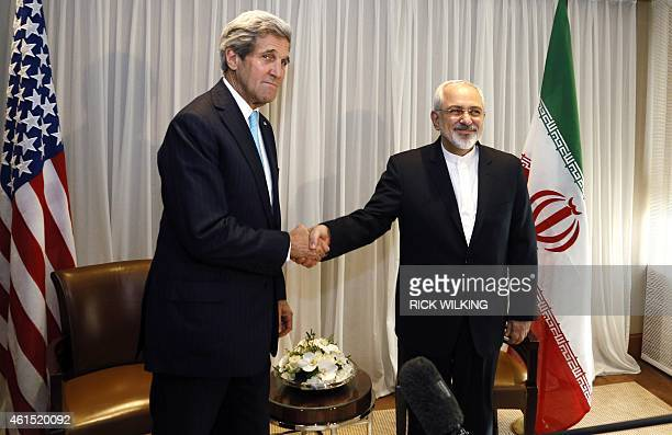 Iranian Foreign Minister Mohammad Javad Zarif shakes hands on January 14 2015 with US State Secretary John Kerry in Geneva Zarif said on January 14...