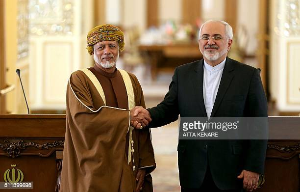 Iranian Foreign Minister Mohammad Javad Zarif shakes the hand of Omani Minister of Foreign Affairs Yussef bin Alawi bin Abdulla following a press...