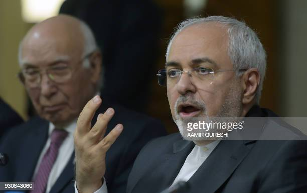 Iranian Foreign Minister Mohammad Javad Zarif speaks as Deputy Chairman of Pakistan's Planning Commission Sartaj Aziz looks on during an event at the...