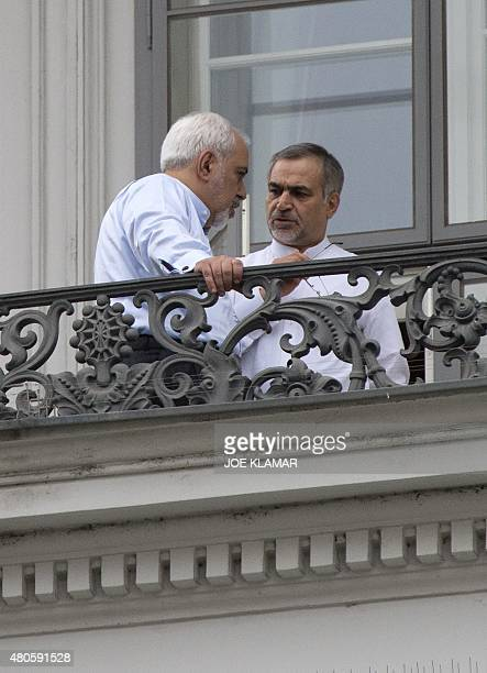 Iranian Foreign Minister Mohammad Javad Zarif speaks to his deputy Hossein Fereydoun on a balcony of the Palais Coburg Hotel where the Iran nuclear...