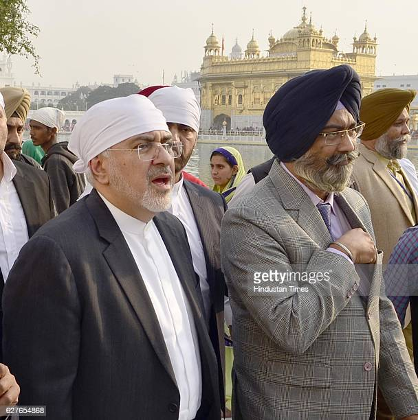 Iranian Foreign Minister Mohammad Javad Zarif with delegation members paying obeisance at Golden Temple on December 4 2016 in Amritsar India