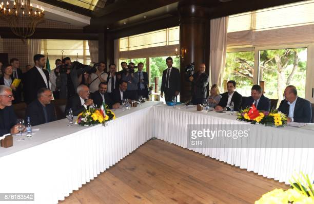 Iranian foreigner minister Mohammad Javad Zarif and Turkish Foreign Minister Mevlut Cavusoglu attend a meeting in Antalya on November 19 2017 as top...