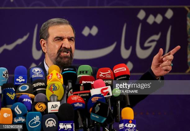 Iranian former chief of the Revolutionary Guards Mohsen Rezai talks to the media after registering his candidacy for the June presidential elections,...