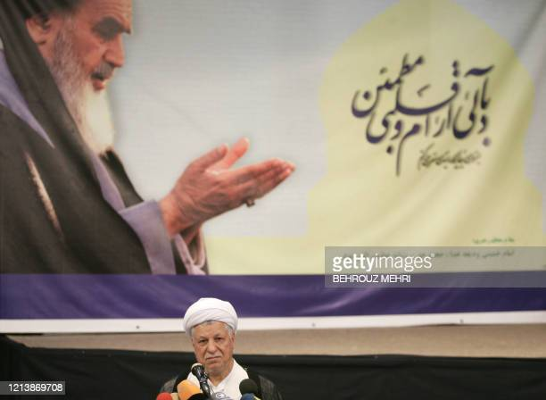 Iranian front runner presidential candidate and former president Akbar Hashemi Rafsanjani speaks to the media after casting his ballot for the...
