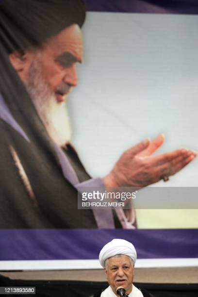 Iranian frontrunner presidential candidate and former president Akbar Hashemi Rafsanjani speaks to the media after casting his ballot for the...